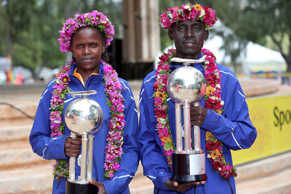 HONOLULU, HI - DECEMBER 10:  (L-R) Bridgid Kosei of Kenya and Dennis Kimetto of Kenya pose with trophies after winning the Men's and Women's divisions of the Honolulu Marathon 2017 on December 10, 2017 in Honolulu, Hawaii.  (Photo by Tom Pennington/Getty Images for HONOLULU MARATHON) *** Local Caption *** Bridgid Kosei; Dennis Kimetto